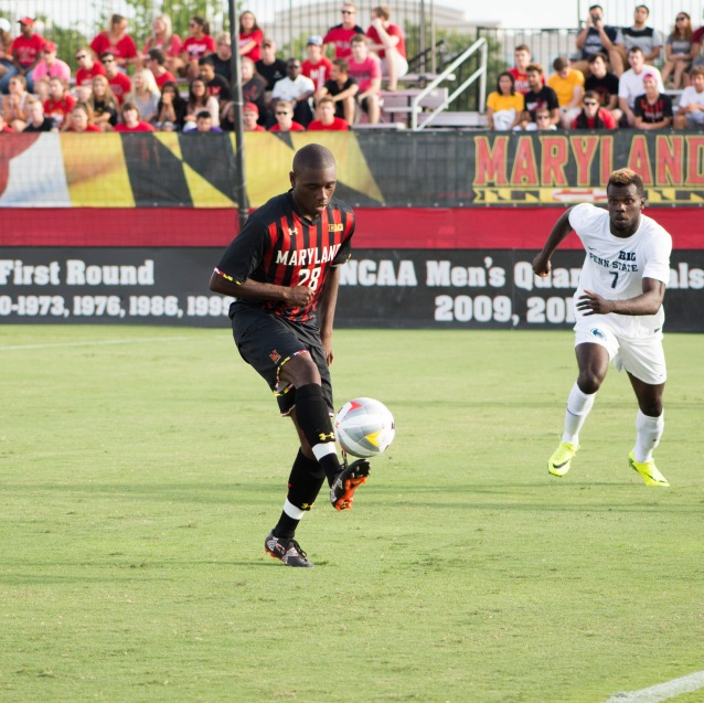 Senior Chris Odoi-Atsem tries to control the ball during the Terps 3-2 win over Penn State on Sept. 18. The defender scored in the final minute to tie the game, his first goal of the season.