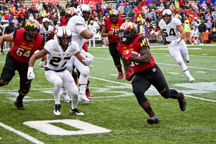 Kenneth Goins Jr runs the ball during Saturday's win over Purdue. Photo by Lauren Anikis.