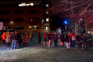 "Students waited outside for over an hour before an ""All Clear"" was called. (Photo by Heather Kim)"