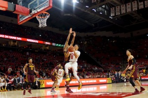 Anthony Cowan goes for a layup. (Photo by Heather Kim)