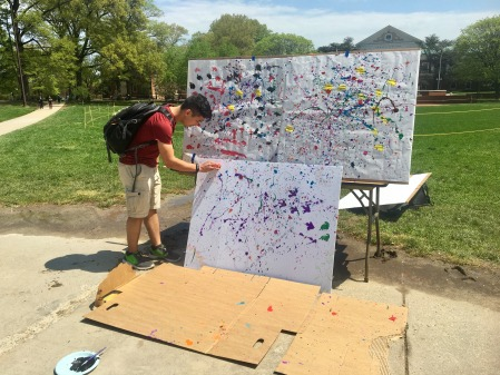 Students paint at Stress Less Carnival