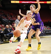 Senior guard Kristen Confroy drives the ball toward the basket.