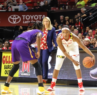 Senior guard Ieshia Small coordinates a play with head coach Brenda Frese looking on.