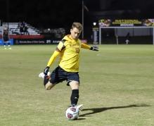 Junior midfielder Amar Sejdic plays a long ball against Albany.