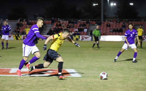 Senior forward George Campbell gets by an Albany defender.