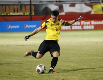 Senior forward George Campbell plays a long ball for the Terps against Albany.
