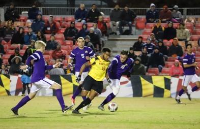 Junior midfielder Eryk Williamson bursts through Albany's defense.