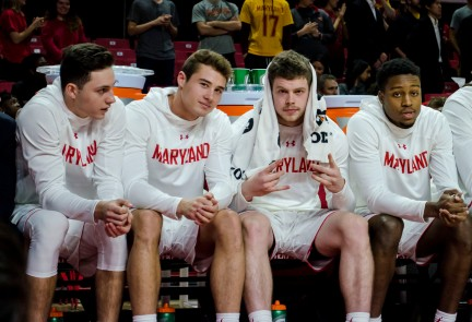Freshmen Alejandro Tostado, Reese Mona and Juniors Andrew Terrell and Travis Valmon watch from the bench.