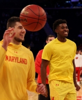 Cekovsky and Morsell laugh after Cowan dunks during warm ups.