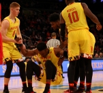 Huerter (4) and Morsell (10) help Fernando to his feet.