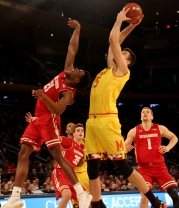 Michal Cekovsky (15) rebounds the ball.