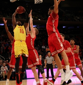 Darryl Morsell (10) attempts to shoot surrounded by Wisconsin players.