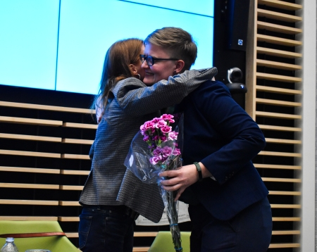 Current director of LASC Britta Anderson hugs a former director at the end of the center's 30th anniversary celebration